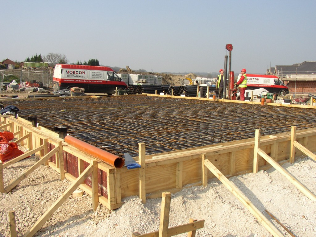 Piled raft foundation for new build domestic property. Shuttering and reinforcement in place prior to concrete pour.