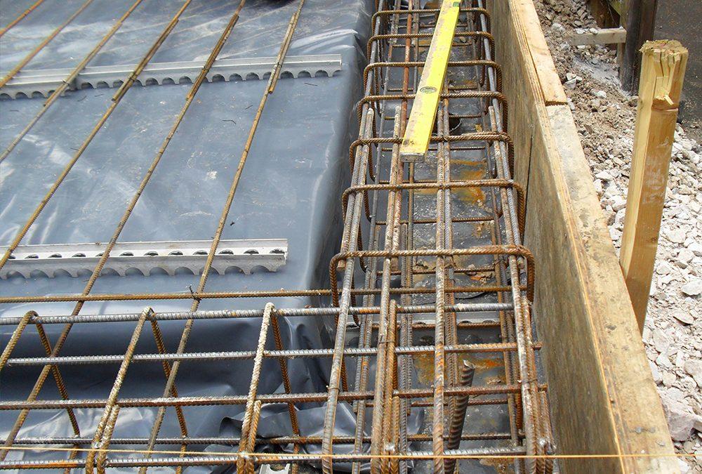 Piled raft garage foundation